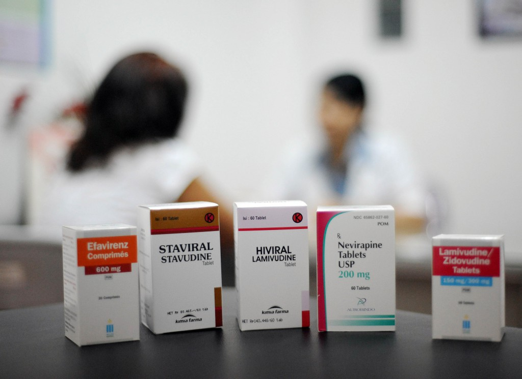 Boxes of antiretroviral medicines sit on
